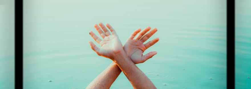 film with photo of faceless person hand above pool