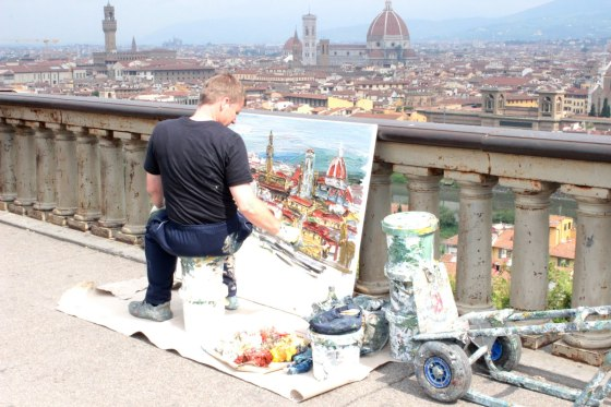Street Painter in Piazzale Michelangelo painting the girl next door