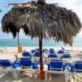 Beach chairs under a straw umbrella in Puna Cana, Dominican Republic