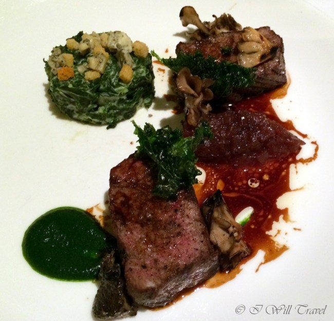 48-day dry aged beef rib eye, oxtail, pomme surprise, onion relish, Fourme d'Ambert creamed kale