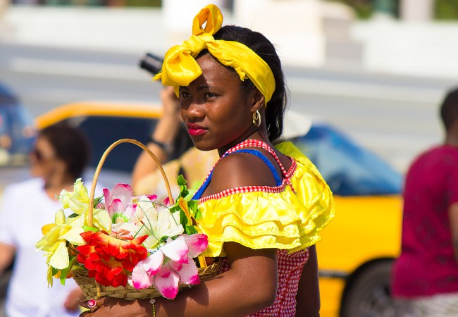 Just outside the Capitol building, you will find many Afro-Cuban women dressed in colorful dresses carrying flowers.
