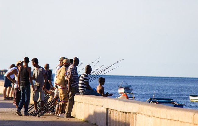 People fishing in Havana's Malecón.