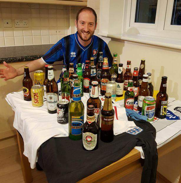Man Displays Beers From 32 Countries Participating At The World Cup