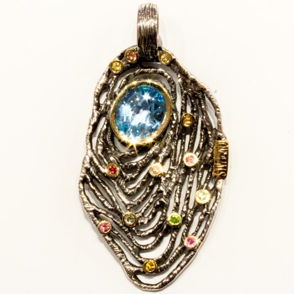 Unique Blue Topaz and Tourmaline Pendant with Silver and Gold
