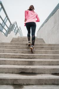 Sport woman running on stairs.