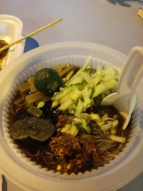 Night market meal - preserved chicken egg in there