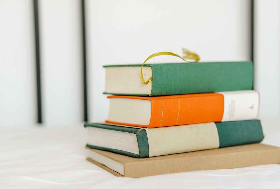 stack of books on white fabric