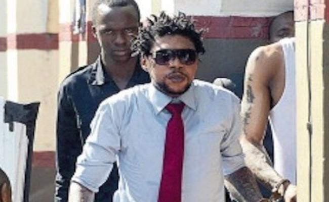 Vybz Kartel murder trial damning incriminating audio evidene tattoo on hand court Clive Lizard Jamaica