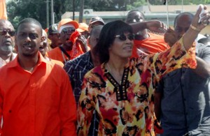 Prime Minister Portia Simpson Miller and People's National Party candidate Dwayne Vaz - Source: jamaica-gleaner.com