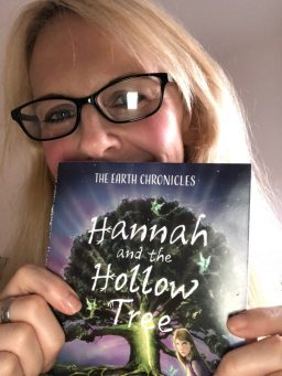 J A Browne with the first copy of Hannah and the Hollow Tree, Book One in the environmental fantasy series The Earth Chronicles