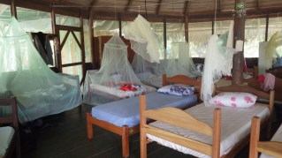 Rooms crammed with beds and all-important mosquito nets!