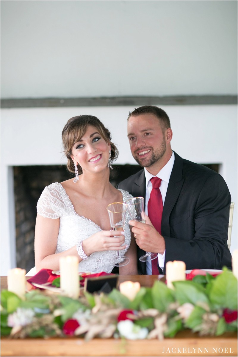 Leila and Matt toasting at the head table.