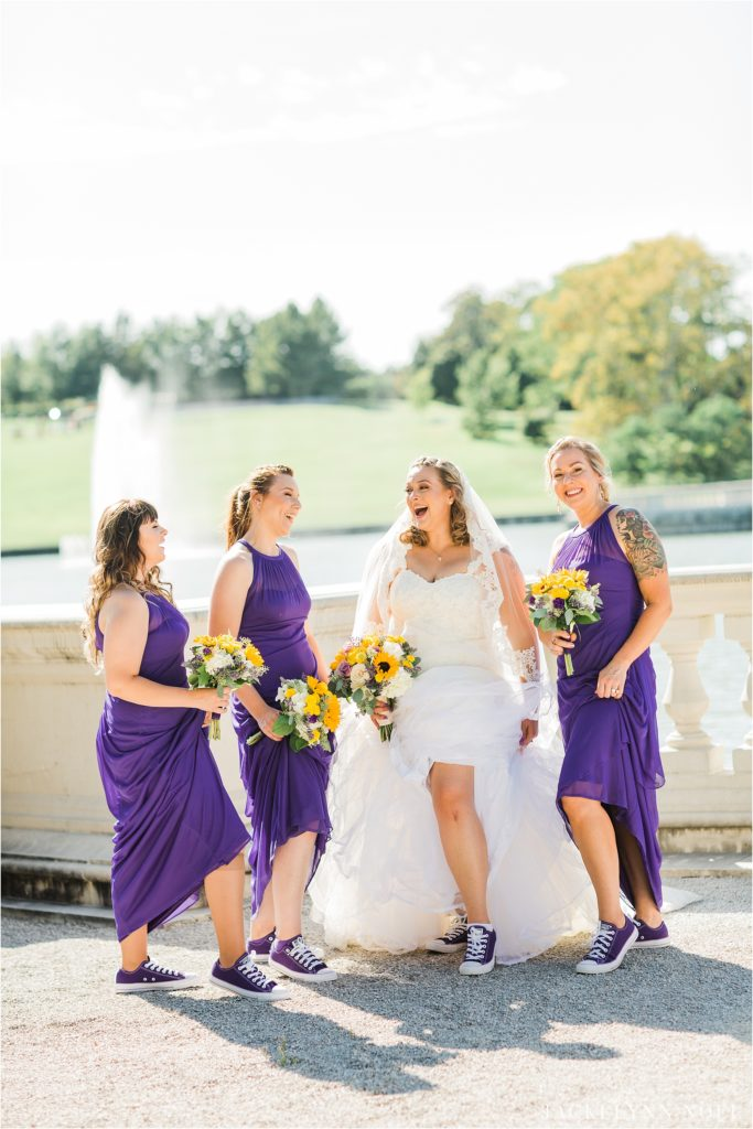 Lisa and her bridesmaids show off their purple converse shoes