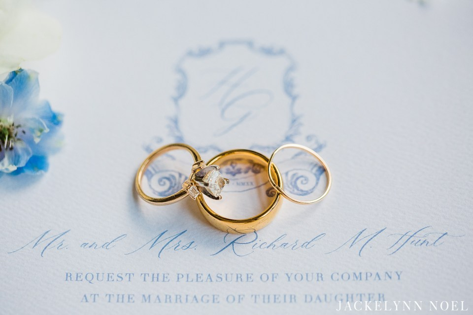 Wedding rings on white and blue wedding invitation design by Mollie Paperie.