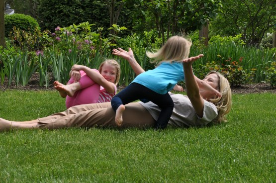 family playing on grass