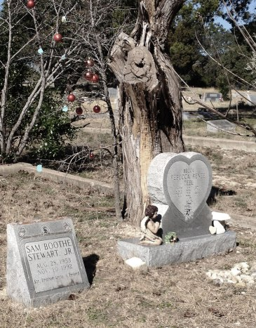 heart-shaped headstone and christmas decorations in tree