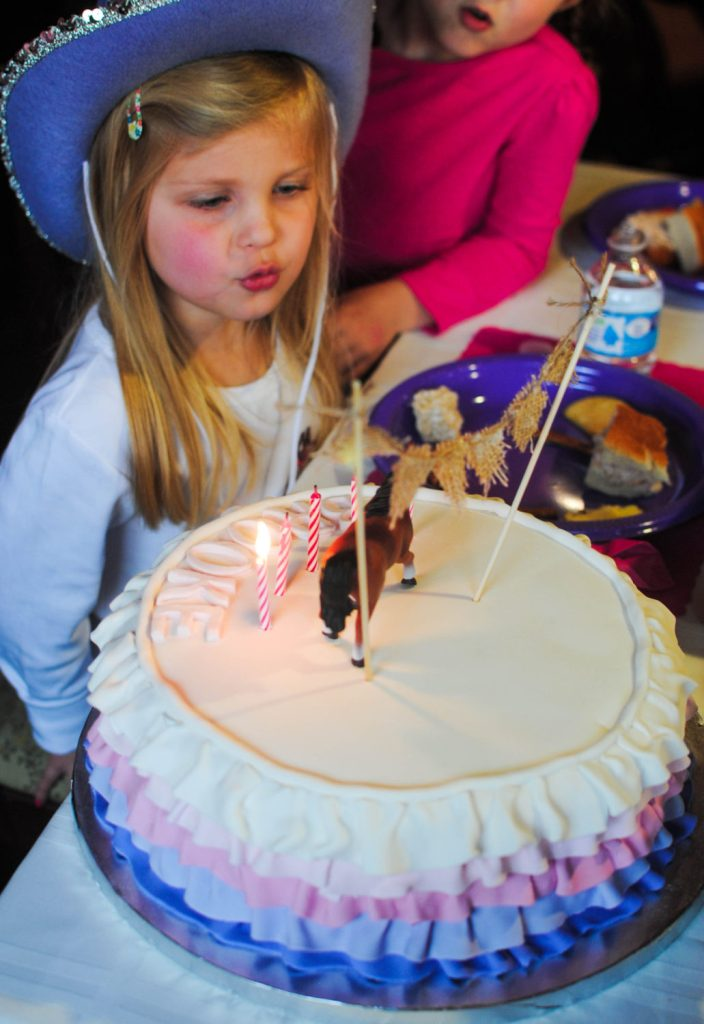 brookie with cake blowing out candles_