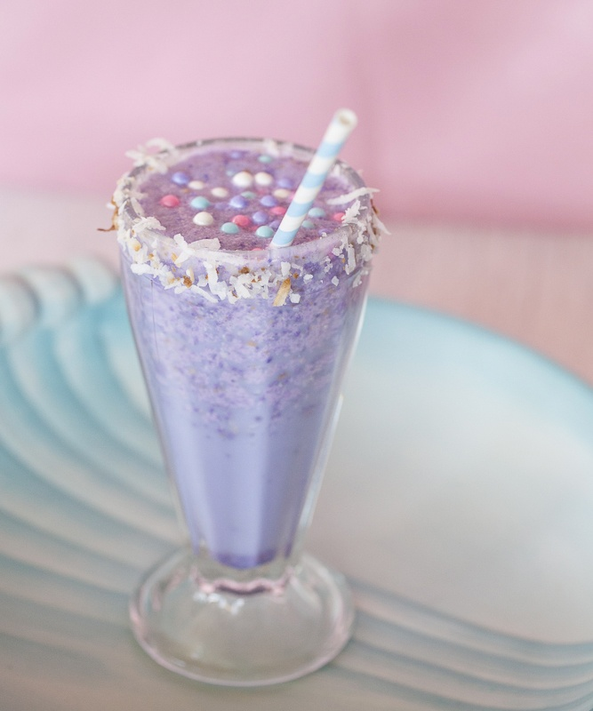 purple frozen cocktail with sprinkles
