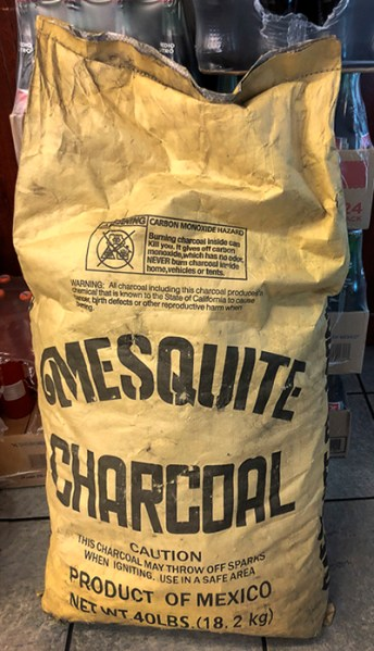 big bag of mesquite charcoal product of Mexico