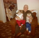 My cousin, DeAnna Swalley, and I sitting on Grandpa Weese's lap.
