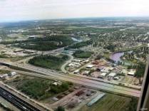 Here we see the Chena River meandering through Fairbanks and the intersection of Johansen and Peger Road on the left. The Carlson Center is the large green building in the upper left. One of the newest and most expensive neighborhoods of Fairbanks is Doyon Estates which is on the right, inside one of the the loops of the Chena River.