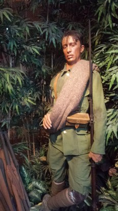 A museum mannequin dressed as a solider in the jungle