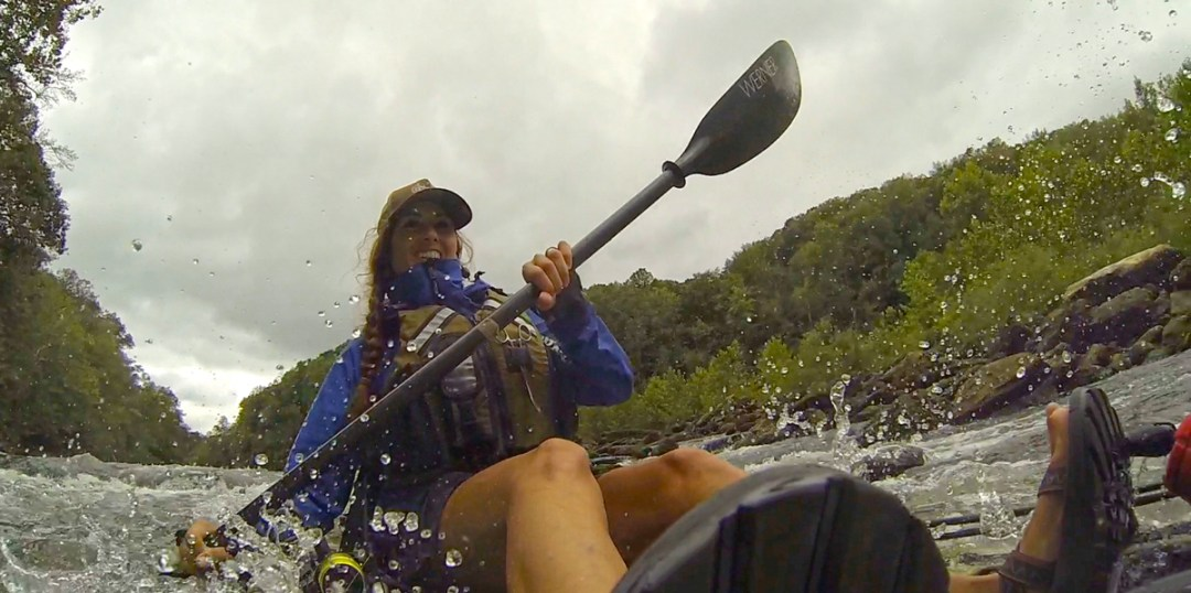 paddling down rapids in Jackson Kayak Coosa HD