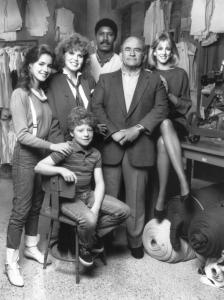 OFF THE RACK, Claudia Wells, Eileen Brennan, Cory Yothers (seated, front), Dennis Haysbert, Ed Asner, Pamela Brull, 1984. © Warner Bros.