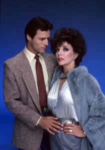 "UNITED STATES - DECEMBER 17: DYNASTY - ""Gallery"" 1983 Michael Nader, Joan Collins (Photo by ABC Photo Archives/ABC via Getty Images)"