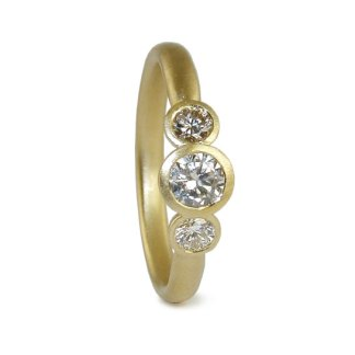 Diamond trilogy ring in 18ct yellow gold. Engagement ring designed by Jacks Turner