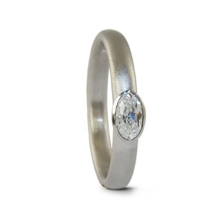 Oval diamond platinum engagement ring designed by Jacks Turner