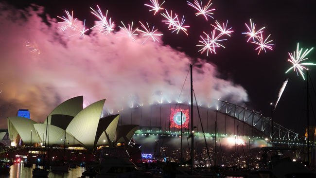 Fireworks behind the Australian Opera House and Sydney Harbour Bridge, a popular attraction on Australia Day.