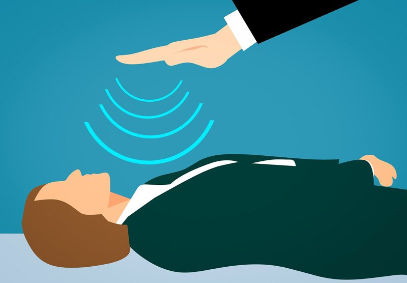 Person receives energy healing or prayer which skeptics are sceptical of for the most part.