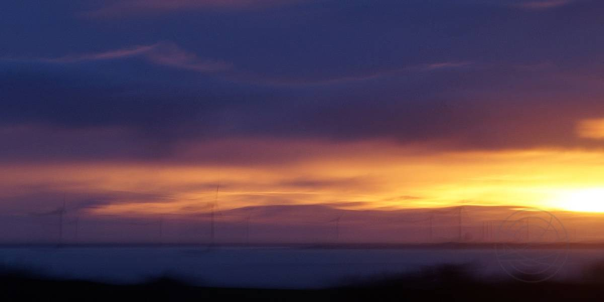 Solar Winds - Sunset above the Limfjord, Denmark. the sun is blowing with its last breath toward the wind turbines. A fusion of renewable energy :) - Abstract realistic fine art landscape photography by Jacob Berghoef