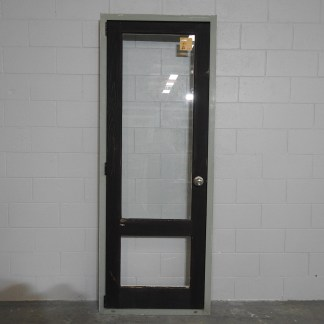 Wooden (Cedar) exterior door hung in aluminium frame