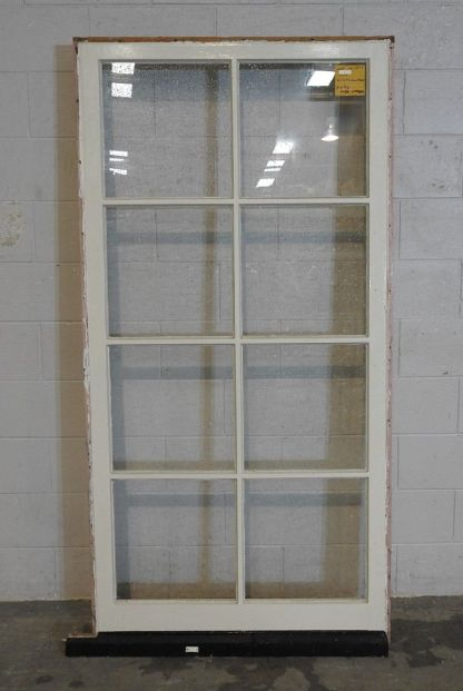 tall colonial style wooden fixed pane window