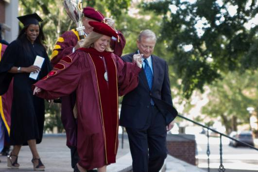President Comstock walking out of Byrnes Auditorium after her first Convocation as President of Winthrop.