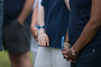Winthrop staff wear blue ribbons to honor the memory of the Mother Emanuel shooting victims.