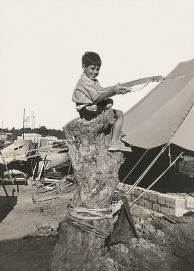 Young Jacob at a British Mandate military camp, defending Jerusalem with a toy gun! (1947)