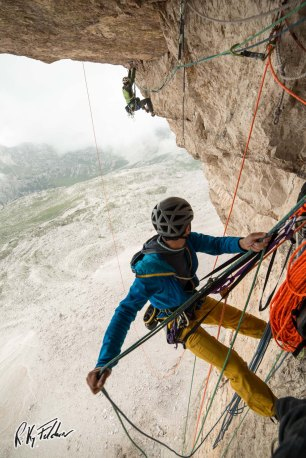 """Trying the crux pitch of """"Pan Aroma"""", Tre Cime - Credits: Riky Felderer"""