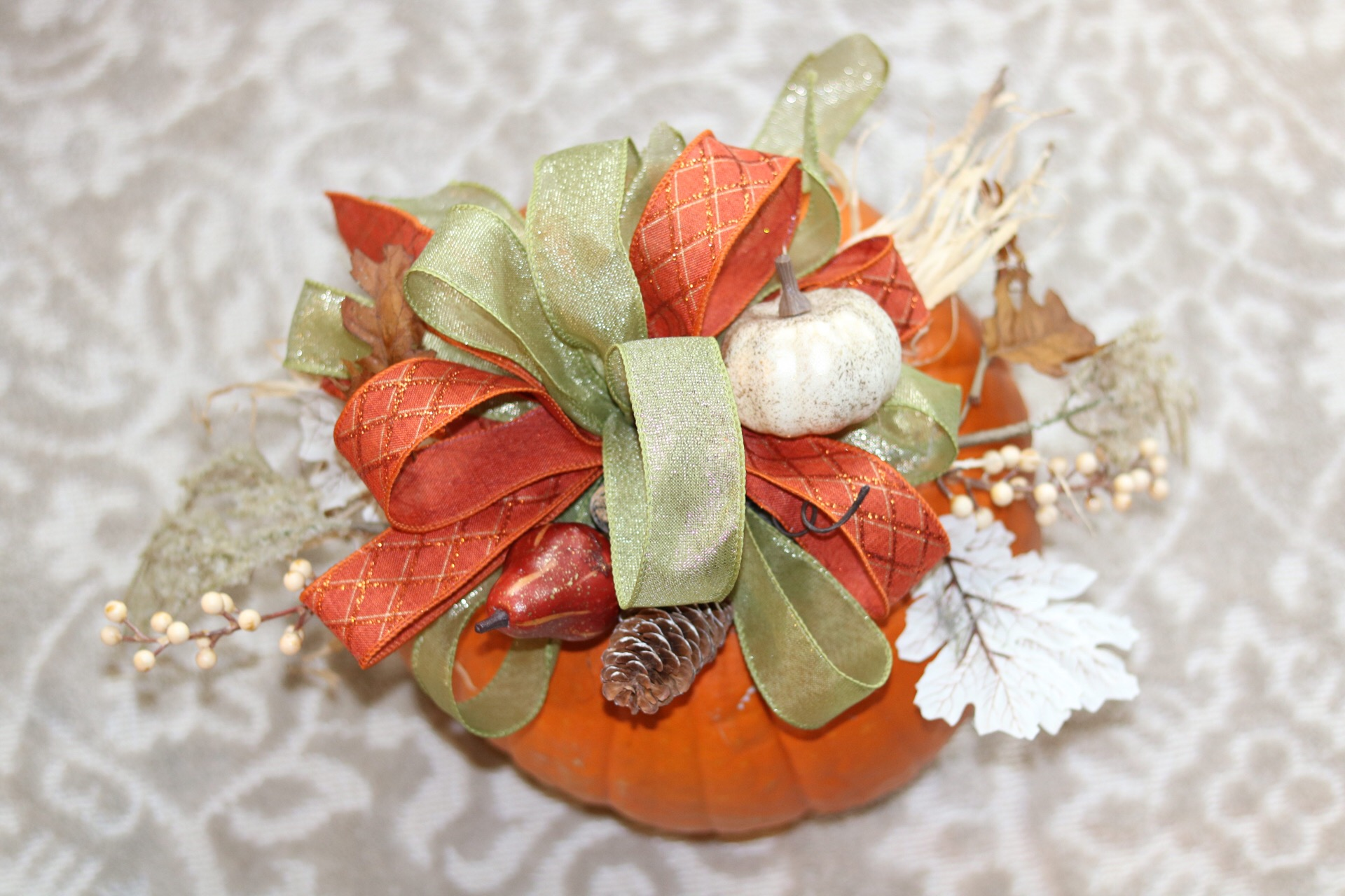 Are you wanting to create a custom fall centerpiece, but don't know where to start? If you grew pumpkins in your summer garden or are picking one from a local pumpkin patch, follow this easy DIY to create your own unique pumpkin centerpiece!