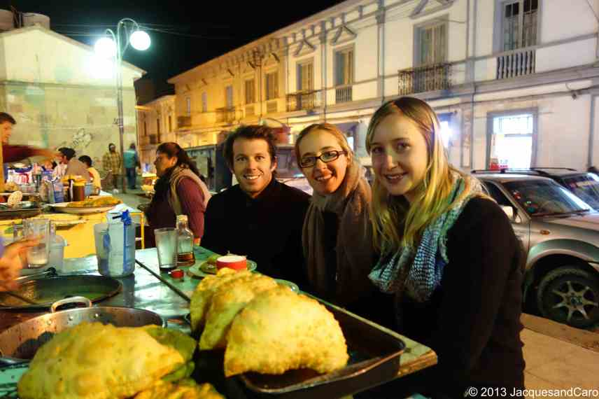Jacques, Caroline and Lea at one many food stalls in the street