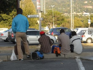 Men waiting for transport - on my way to my first stop for the day - Department of Home Affairs