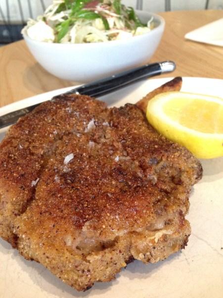 Pork Chop with shaved cabbage, ricotta, radish