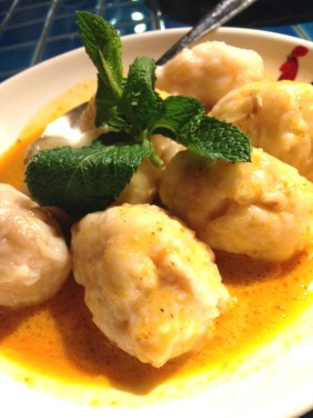 Prawn dumplings in a mild red curry sauce