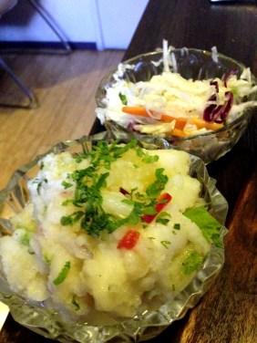 The sides - a slaw and a potato salad