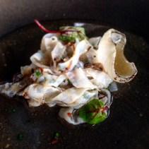 Shaved squid, dried chicken, herbs, white onion, smoked pork fat