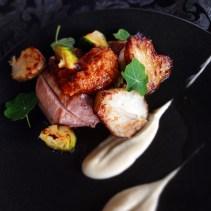 Sous vide pork loin, roasted artichoke, brussel sprout, pork skin crumble