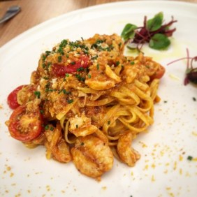 The famous Fresh guitar string egg pasta with blue swimmer crab, roasted lobster sauce and bottarga