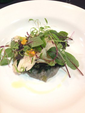 Butter poached Barossa chicken salad stuffed with truffle, finished with petit salad of pea shoots, herbs and kale
